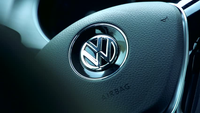 CZECH REPUBLIC, PRAGUE - OCTOBER 25, 2015: Slowmotion detail view on steering wheel of Volkswagen car.