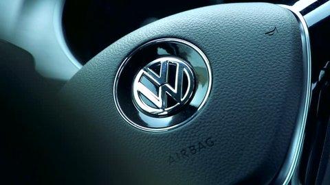 CZECH REPUBLIC, PRAGUE - OCTOBER 25, 2015: Slowmotion detail view on steering wheel of Volkswagen car.