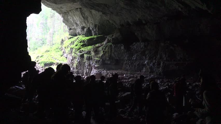 ROMANIA, ALBA, SEPTEMBER 21, 2015 4K Tourists Exploring Mountains Cave Guide Explorer, People Pestera Coiba Mare #14455813