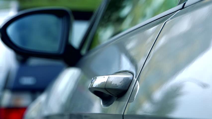 Slowmotion man close the door of car