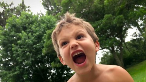 Young boy yelling from the top of his lungs during holiday vacations / ultra slow motion clip in 120 fps