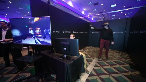 """LOS ANGELES - JAN 23: VR enthusiast tries """"Raw Data"""" at the Virtual Reality Los Angeles Winter Expo on Jan 23, 2016 in Los Angeles. The room scale android survival game is made by Survivors."""