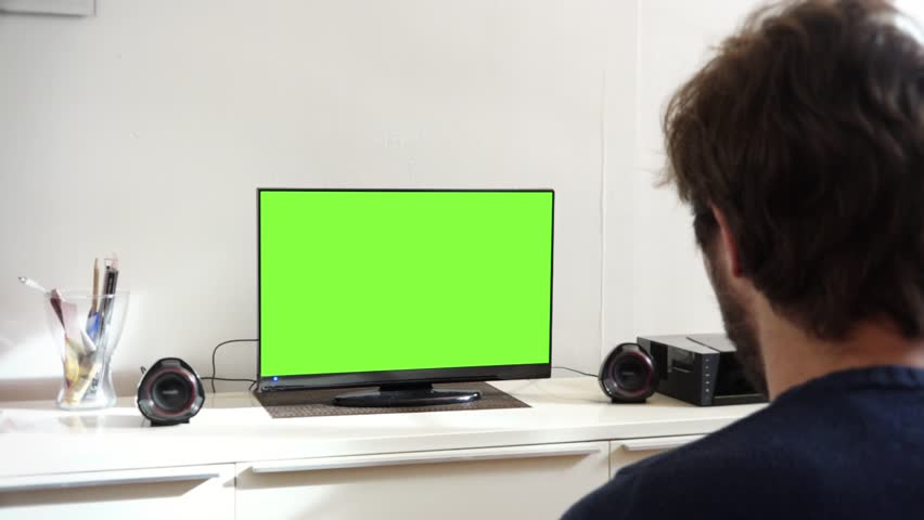 Young Man Watching Television Green Screen in Living Room  Young man  watching television green screenTelevision Computer Green Screen   1080p TV And Computer Green  . Desktop Computer Living Room. Home Design Ideas