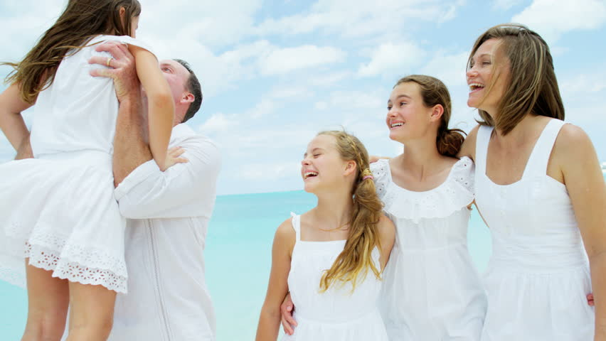 Loving young Caucasian parents female children healthy outdoor freedom carefree luxury beach ocean shallows happy advertisement RED DRAGON | Shutterstock HD Video #14556535