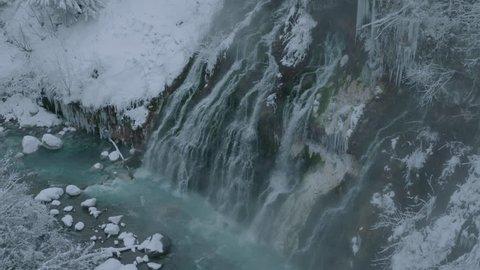 Waterfall with Ice, Snow & Hot-spring in Hokkaido, Japan.