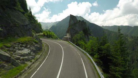 Transfagarasan road crossing Fagaras mountains, Romania. Aerial shot of the famous Romanian landmark.