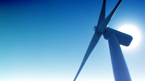 Aerial view Wind turbines Energy Production footage turbines blue sky Power generation wind turbines solar panels Seamless looping animation, wind turbines spinning renewable electric energy source