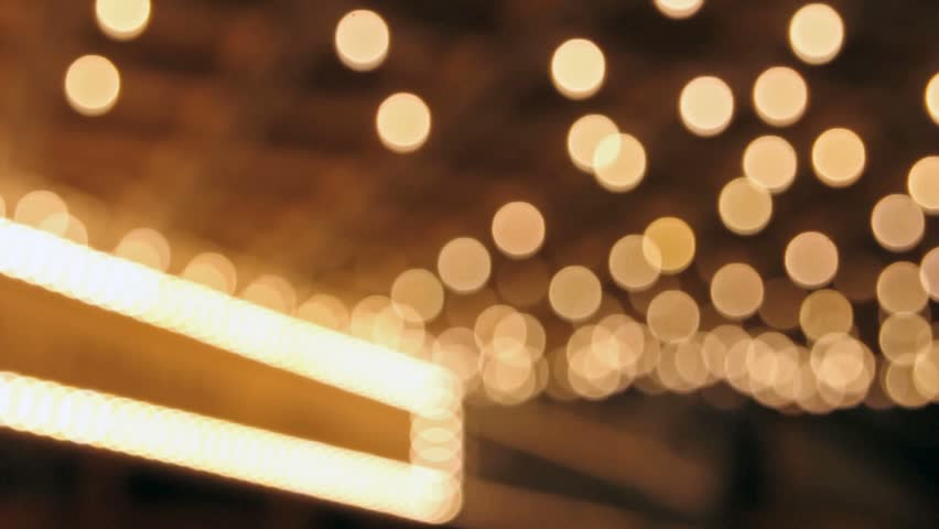 High definition movie of blinking out of focus blurred bokeh concert hall theater lights on broadway along a entertainment street 1080p #14587324
