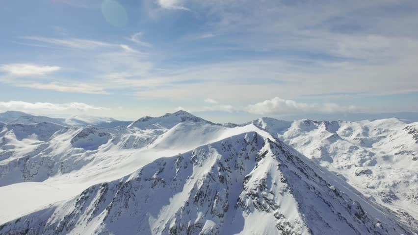 Aerial Flight Over Beautiful Mountains Alpine Mountain Ridge Rocky Peak Snow Winter Landscape Nature Outdoors Epic Adventure Inspiration Background