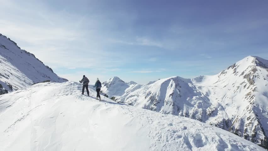 Man Woman Couple Hiking Climbing Mountain Slope Winter Vacation Exploration Expedition Snow Peak Adventure Success Danger Extreme Nature Concept | Shutterstock HD Video #14596564