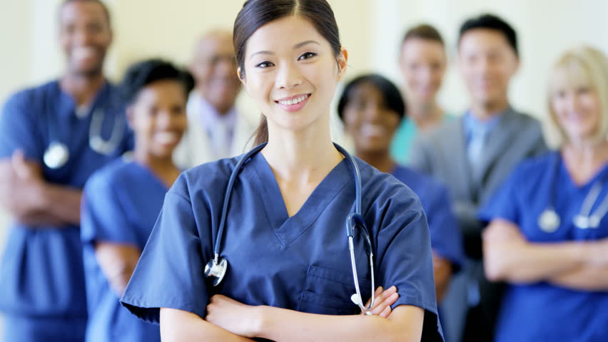Portrait Of Confident Asian American Female Nurse And Team -3956