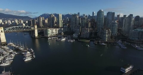 VANCOUVER,CANADA - CIRCA February 2016 :aerial flight towards burrard bridge downtown skyline