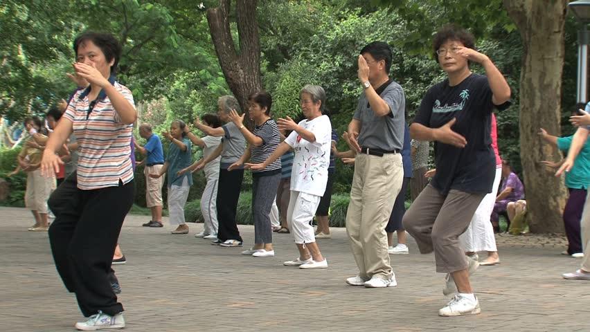 SHANGHAI - CIRCA 2011: Tai-chi in the park circa 2011 in Shanghai