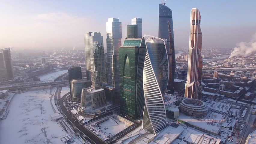 WINTER Moscow city business center. Russian skyscrapers. Cowered in snow and ice. Aerial FPV Drone Flights. UltraHD 4K