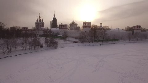 Novodevichy convent. Russian churches. Beautiful frozen WINTER Moscow city cowered in snow and ice. Aerial FPV Drone Flights. UltraHD 4K