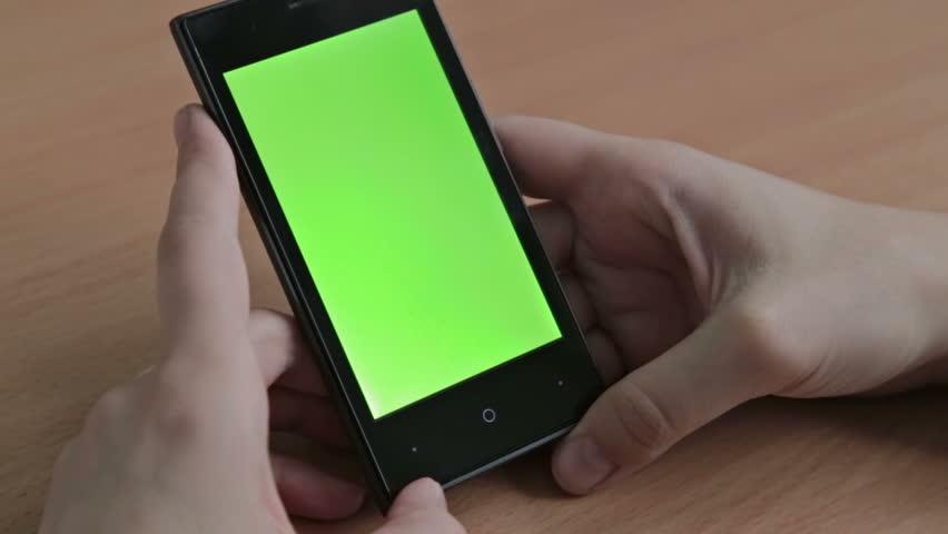 Woman watch oh her cell phone, green screen | Shutterstock HD Video #14650723