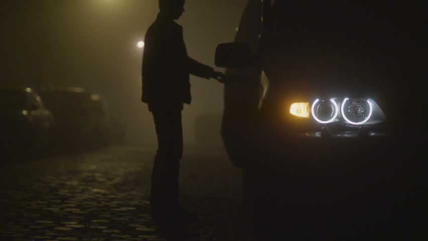 2 in 1 video! The man sit down and get out of the car. Evening-night time, foggy weather, real time capture
