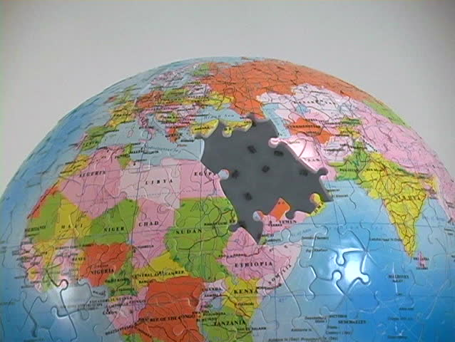 A World Globe Puzzle Has The Middle East Pieces Missing Stock