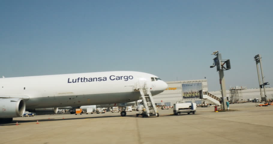 FRANKFURT, GERMANY - CIRCA 2016: Driving through airport with  McDonnell Douglas MD-11F of Lufthansa Cargo plane loading unloading preparing to take off terminal