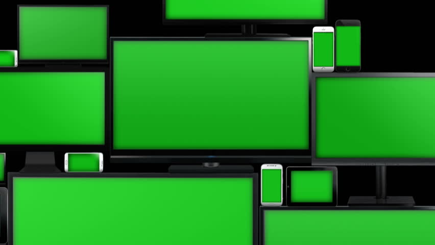 Many different types of screens. TVs, computer monitors, smartphones and tablets. They laid on each other in a pile isolated on a white background. They are all with a green screen. With alpha.