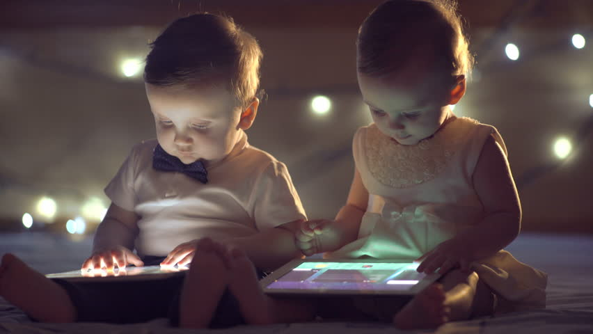 Two children playing with a tablet | Shutterstock HD Video #14719153
