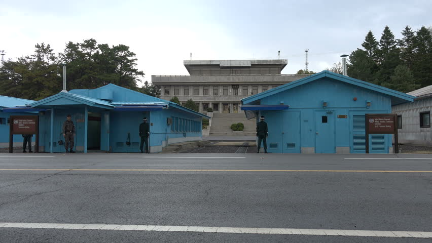 DMZ, SOUTH KOREA - 10 OCTOBER 2015: South and North Korean border, soldiers standing guard, military deadlock, United Nations command and conference rooms