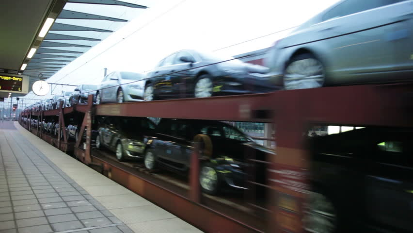 Brand new cars transported by railway from the factory to the store | Shutterstock HD Video #14763733