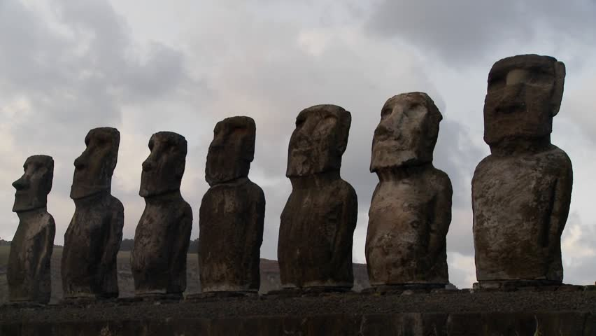 A long line of statues is silhouetted on Easter Island in this time lapse shot.