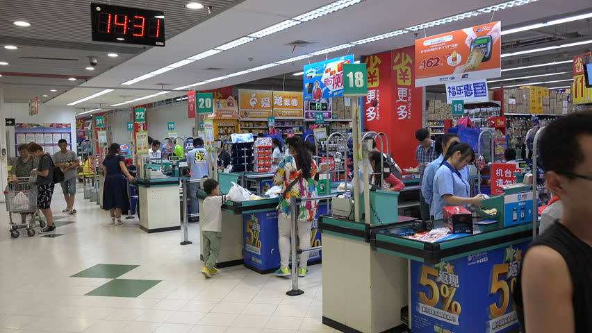 SHENZHEN, CHINA - 21 NOVEMBER 2015: Checkout counters (cash registers) of a French supermarket (Carrefour) in Shenzhen, China