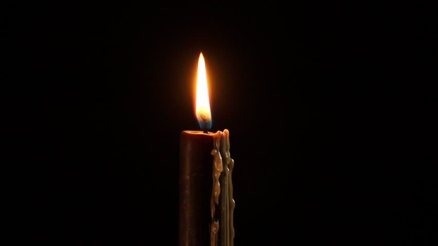 Candle flame black background