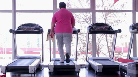 Overweight woman doing exercises, fat senior lady working hard to lose weight