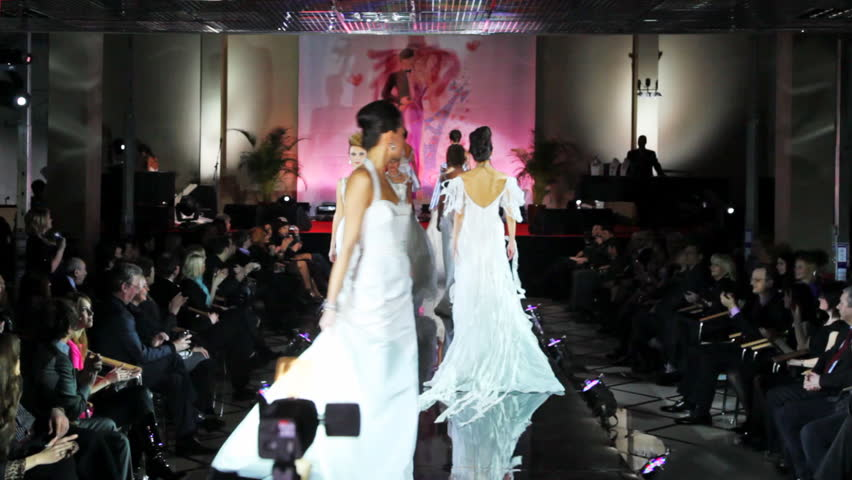 MOSCOW - FEBRUARY 14: Models in white wedding dresses walk catwalk at Evening of French fashion in salon Estet, on February 14, 2011 in Moscow, Russia.