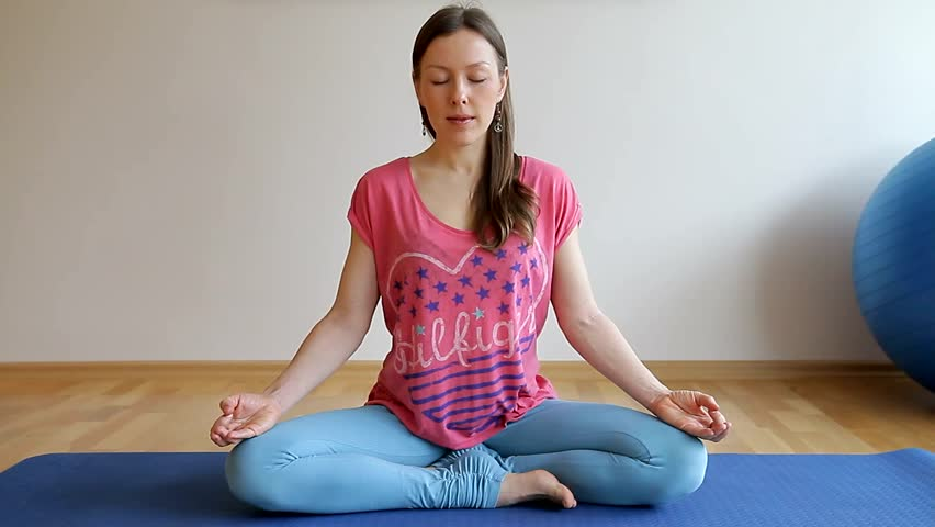 Woman making yoga hand greeting namaste close shot of face stock woman meditating in yoga class with open hands with mudras close shot hd m4hsunfo
