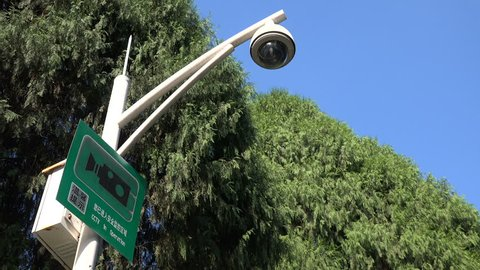 Surveillance camera in operation, government control, police security, prevention, Shenzhen, China