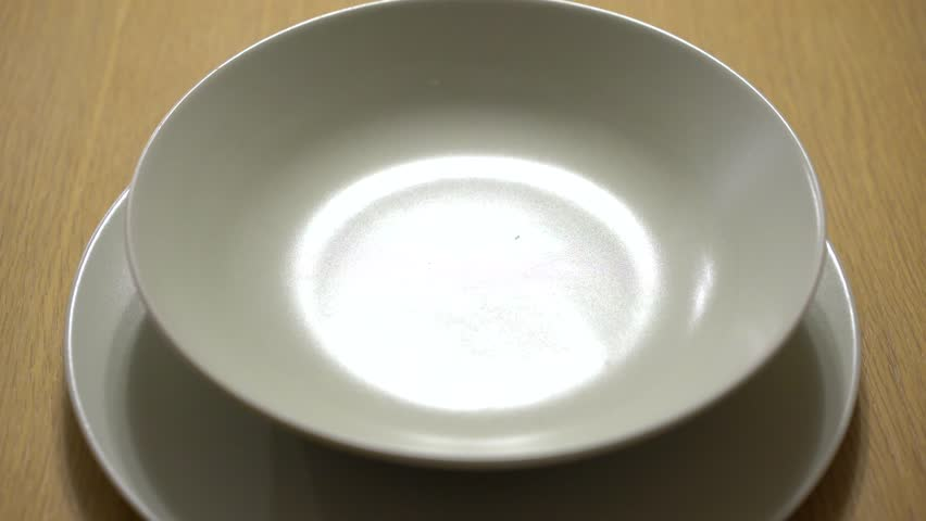 Vegetable soup is poured in a white dish. #14913991