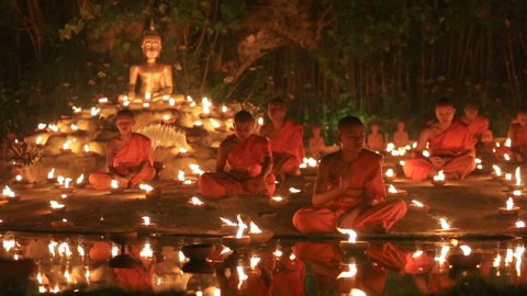CHIANG MAI THAILAND - FEBRUARY 22 : Magha puja day is the important incidents Buddhist day. Buddhist monks light the candle for buddha . Feb 22, 2016 in Phan Tao Temple, Chiangmai, Thailand.