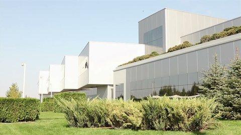 Exterior of modern storehouse or factory,  tile manufacturer plants, ceramics tiles manufacturing, exterior of the modern plant, Modern plant, building exterior,  industrial exterior, modern factory,