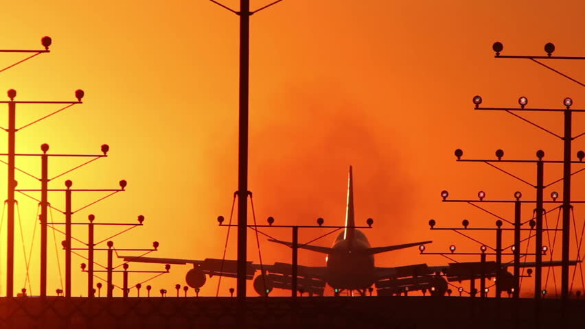HD footage of a 4 engine jumbo jet plane landing in silhouette against an orange sunset sky.  Jet engine audio included. | Shutterstock HD Video #1510678