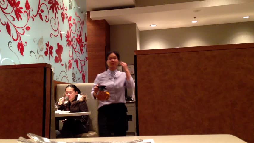 Burnaby, BC, Canada - April 30, 2014 : Low angle of couple eating food at Chinese restaurant | Shutterstock HD Video #15107233