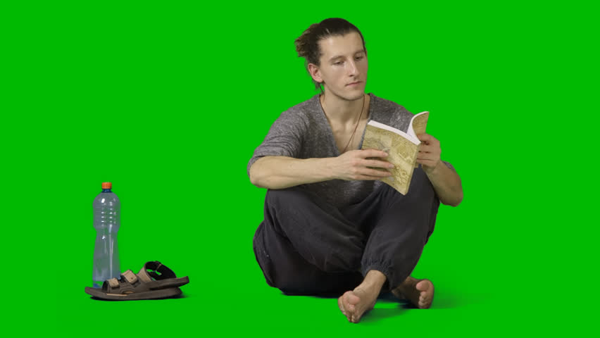 Barefooted male squats crosslegged and reads book. Footage with alpha channel. High quality keying without holes & chatter. File format - mov. Codeck - PNG+Alpha
