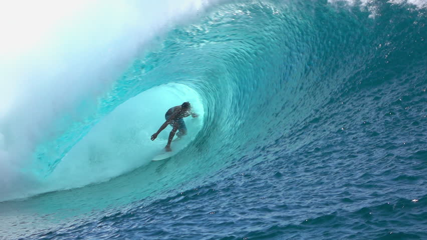 SLOW MOTION: Cheerful extreme pro surfer surfing big tube barrel wave Teahupoo in crystal clear Pacific ocean in sunny Tahiti island - HD stock video clip