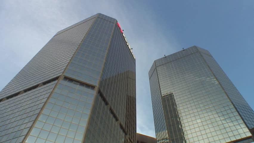 Multiple short tracking shots of modern office buildings; low angle, street to sky, Denver Colorado