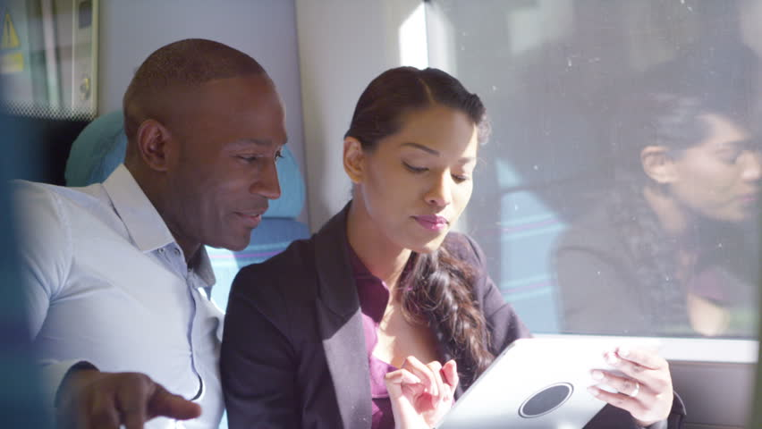 4k Happy attractive ethnic couple using computer tablet on train journey. | Shutterstock HD Video #15194293