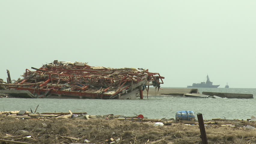 Japan Tsunami Aftermath - Flooded Building With Navy Ship In Background Off Rikuzentakata City - Full HD 1920x1080 30p.
