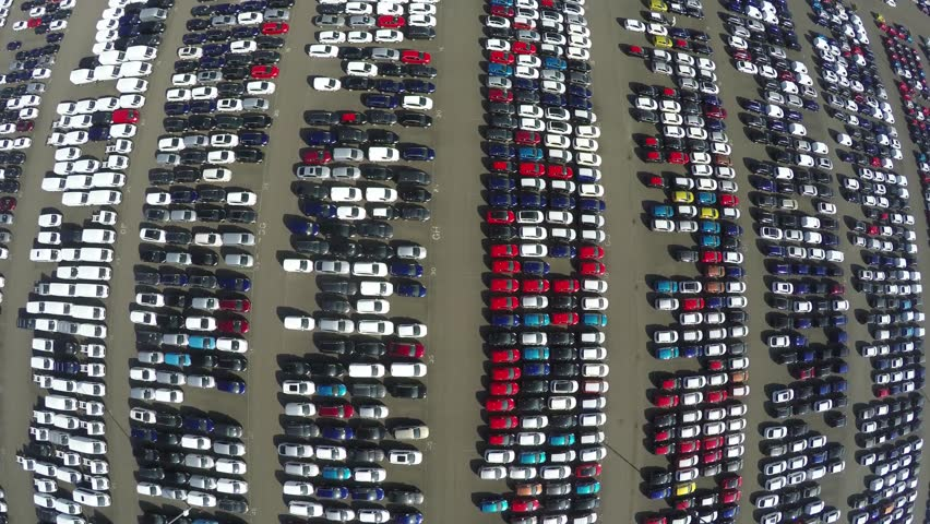 Aerial top down view reverse of new car storage parking lot showing imported new vehicles or ready to export new automobiles storage facility car industrie for American and European market 4k quality | Shutterstock HD Video #15207196