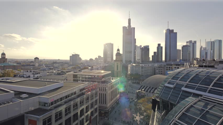 Frankfurts biggest shopping street (Zeil) plus skyline filmed from a roof above. 