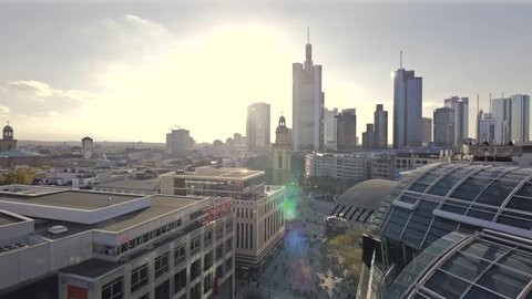 Frankfurts biggest shopping street (Zeil) plus skyline filmed from a roof above.