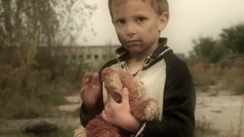 Orphan. Abandoned, lonely child. Ruins in the background. Camera dolly. Canon 7d, HD 1080 25p