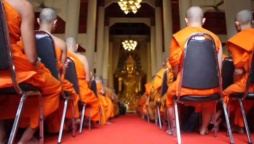 CHIANG MAI, THAILAND - AUGUST 15: Buddhist monks meet inside temple in Wat Phra Singh, August 15, 2011, Chiang Mai, Thailand. Buddhism in Thailand is represented by the presence of Buddhist monks who are responsible for preserving Buddha's teachings.