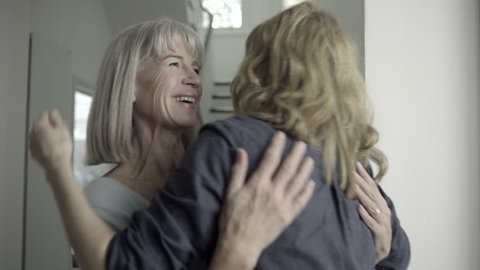 Senior adult woman greeting woman